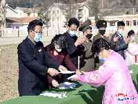 Housewarming scene in disaster areas of different ris and town in Kimhwa County